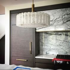 Marble and brass hood. #midcentury #vintage pendants from @lynngoodevintage were just installed in the kitchen. | Canadian interior designer Nam Dang Mitchell