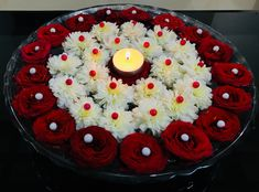 Flower decorations - Floating Flowers Decorated With Thermocol Balls N Beautiful Candle Rangoli Designs Flower, Small Rangoli Design, Colorful Rangoli Designs, Flower Rangoli, Rangoli With Flowers, Kolam Designs, Arti Thali Decoration, Ganapati Decoration, Decoration For Ganpati