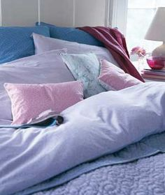 Top your bed with covers made for snuggling, like a down comforter. For total indulgence, choose ultra-soft eiderdown.