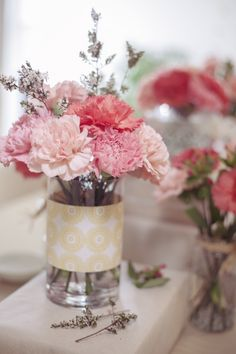 Simple Pink Carnation Centerpieces - I really like these! Easy to put some patterned paper on jars or something.