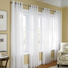"$69 ThermaVoile Grommet Top Curtains 95""  With ThermaVoile Grommet-Top Curtains, you can enjoy the airy look of sheers and still insulate your windows against heat loss, drafts, and hot sun. Designed of polyester voile with a thick polyester backing and 2-3/8""-diameter antique-brass grommets, these insulated curtains provide a fashion look that helps block outside cold & heat."