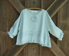linen top flare with ruffle, tucking and a rose in lt. dusty blue. $125.00, via Etsy.