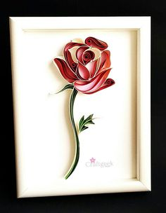 Rose, Paper Quilled Framed Single Red Rose, Quilled Paper Art. It is a original handmade artwork, made using paper in quilling technique. for extra cuteness added rhinestone over it to give dew drops effect. It is placed in white deep frame, size is 15x20cm( 6x8 inches) without mat. Ordered rose will be signed at the back and comes framed, as ready to hang on the wall or can be placed on a table, frame is cute and small, so its easy to give as a gift to someone you love. If you want to kn...