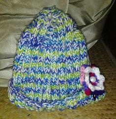 Hat and crocheted flower