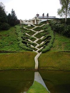 Scotland's Incredible Garden of Cosmic Speculation - This beautiful and powerful staircase is called The Universe Cascade. It has 25 jumps of steps that represent how the universe unfolded over billions of years. As you climb the stairs, you need to look carefully as there are beautiful and mysterious items for you to sit at and contemplate on on each level.