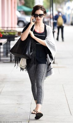 Lily Collins is off-duty as she goes make-up free to work up a sweat at Pilates class