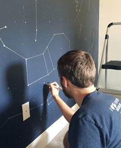 How to draw a wall of constellations with a ruler and a paint pen (so cute and simple).