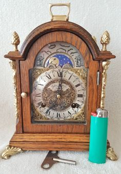 Ends today on eBay & LOW BIDS this Vintage Dutch 8 Day Hermle Bracket Mantel Clock Moon Dial Double Bell Key Brass