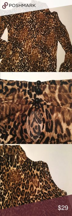 Leopard safari print mockneck cold shoulder NWT XL Macy's Leopard safari print mockneck cold shoulder NWT Size: XL - adorable 3 black round elastic button collar in back - Blousy billowy sleeves - elastic at wrists. Perfect condition. Brand new. With tags. Macys Tops Blouses