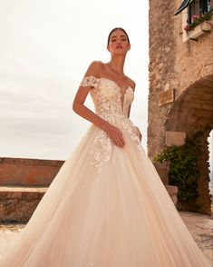 """Nicole Milano on Instagram: """"Say yes like a Princess 🌟 Romantic humeral neckline and a wide skirt made of champagne tulle #Nicole #Nicole2020Collections . . [Dress:…"""" Off Shoulder Ball Gown, Bodice, Neckline, Floral Lace, Ball Gowns, Tulle, Champagne, Romantic, Couture"""