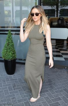 Gorgeous: Perrie looked slender in a fitted khaki dress that skimmed over her figure...