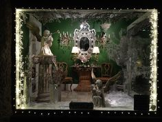 christmas home window decorations - Google Search.....love the green, silver, lights and natural wood with mirror....minus the pillars and angles....