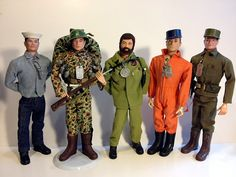 A variety of looks of talking GI Joe.  Talking Sailor with basic uniform and foreign head sculpt.  Talking Hard Head Marine (earlier version talker).  Adventure Team Talking Commander (Hard Hand version).  Talking Pilot, later issue soft head version and Talking Soldier with foreign head.  All armed service talkers could have been issued with any number of heads, (hard soft or foreign) in any hair color combination.  Talking Commanders have been known to have red flocked hair as well.