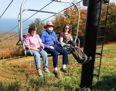 Visitors to Porcupine Mountains Wilderness State Park enjoy a chairlift ride to view the fall colors.