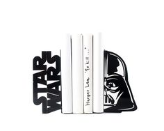 """Decorative bookends Darth Vader Star Wars. Cool and functional book holders to organize your Star Wars collections. Books or DVDs. One pair of metal bookends. Size 7.3"""" x 3.7"""" and 3.9"""" deep or in cm 18.5 x 9.5 x 10 cm. . Holds a long row of books or disks. FREE WORLDWIDE SHIPPING."""