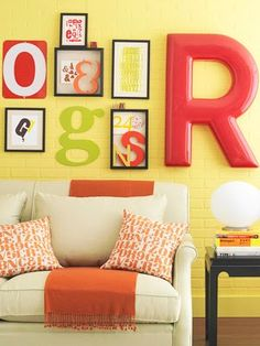 love the red, orange, green and yellow colour scheme. Like the punchy walls with neutral furniture.