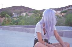 Lilac hair and forearm tattoo