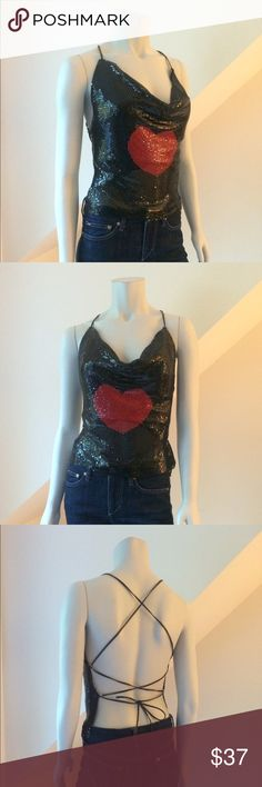 """Love this so much, thanks sis NWT Bisou Bisou Mesh Top NWT Bisou Bisou Aluminum Mesh Top...so fun! under a jacket or on its own...black with red heart...criss cross faux leather strap ties at back...the faux leather means it actually stays in place! tear up the dance floor, it won't move...fully lined...measures approx 16"""" x 16""""...tag reads size 8 but will fit 4-8. Retail $98 Bisou Bisou Tops"""