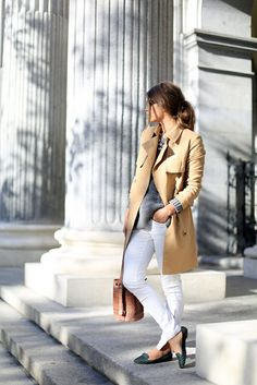 Womens street style fashion: smart casual outfit for work or the weekend: white jeans, trench coat jacket,studded flats, grey knitted sweater jumper, brown woven leather hand bag (mw)