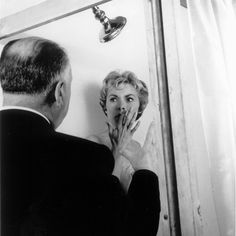 Alfred Hitchcock directing Janet Leigh in the iconic shower scene from PSYCHO ('60)