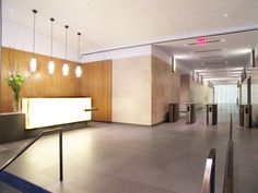 Anigre wood paneling. Backlit white onyx reception desk. Gertler & Wente. 125 Park Avenue. The Pershing Square Building.