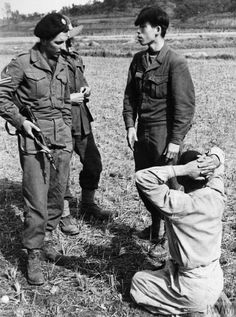 A British corporal and an Australian quiz a kneeling North Korean prisoner of war through an interpreter, during the advance of the United Nations forces northwards from Pyongyang. Prisoners Of War, Korean War, The Twenties, Army, Museums, History, Objects, United Nations, Search