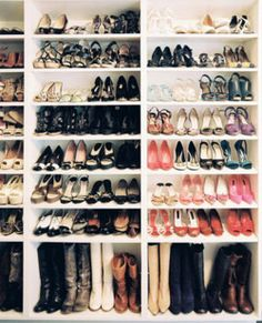 bookcases in the closet for shoes! shorter ones would make the most sense.  Love this!