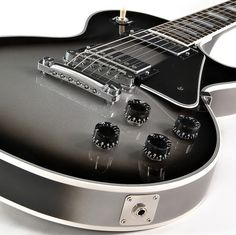 Gibson Les Paul Custom Guitar, Silverburst.  It looks similar to Jake Pitts's guitar...