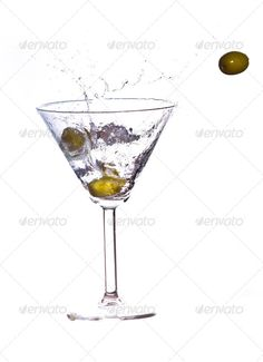 Martini Splash ... <p>olives in a martini Splash on white background</p> alcohol, bar, beverage, booze, bright, bubble, classic, clipping, close, close-up, closeup, cocktail, cold, cool, drink, drop, elegance, falling, fresh, freshness, gin, glass, isolated, liquid, liquor, martini, martini glass, mixed, motion, olive, party, path, reflection, splash, splashing, studio, transparent, up, vodka, water, wet, white