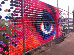 Australian street art duo Hyde & Seek create amazing public art using materials like colored plastic cups, plastic toy soldiers and even toast for that mat Art Environnemental, Art Public, Street Art, East Street, Fence Art, Cup Art, Environmental Art, Recycled Art, Chalk Art