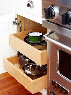 Think about where you'll use the items in your kitchen and store them accordingly. Pullout drawers next to the range store pots and pans making the step from storage to cooktop an easy one.