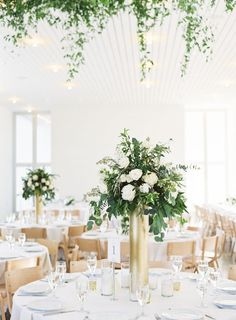 Modern rustic organic tall gold wedding centerpieces: http://www.stylemepretty.com/2016/09/23/romantic-texas-hill-country-wedding/ Photography: Mint - http://mymintphotography.com/