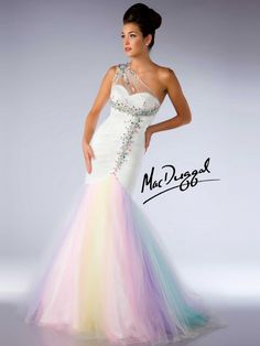 Strapless mermaid silhouette with one shoulder illusion netting and multi color ombre skirt adorned with color stones along the rouched bodice. Stand out from everyone else in this perfect prom dress that looks like it came of the runway.