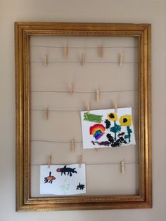 Old picture frame for displaying kids art!