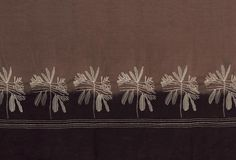 Stone Leaf Emb on taupe linen throw with dip 150x300cm