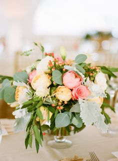 Wedding Centerpieces: Peach + Coral WITH  Greenery -- See the wedding on Style Me Pretty: http://www.StyleMePretty.com/2014/02/11/rustic-elegance-in-beaver-creek-at-red-sky-ranch/ Photography: Erin Hearts Court