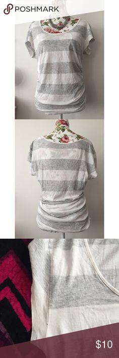 GUESS Striped White / Gray Cotton Top Size Medium This is a summery stripped t-shirt from Guess with gathered sides, giving it a fitted yet causal, loose look at the same time. Perfect for summer days and nights at the beach! Or pair it up with a blazer for a dressier look. In good condition except for a tiny hole by the sleeve (see image). Guess Tops Tees - Short Sleeve