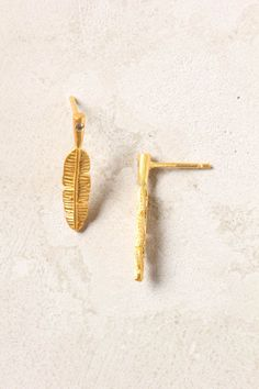 I really love these little feather earrings from Anthropologie. On sale now for $19.95.