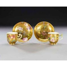 TWO MEISSEN GOLD-GROUND COFFEE CUPS AND SAUCERS CIRCA 1750