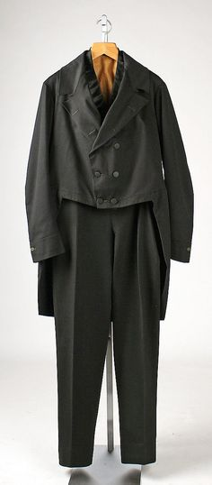 "Men's black wool suit, American, 1864. Label: [written] ""B.W. Benson -- / March 2 / 1864"" Worn with black silk waistcoat, and black silk top hat (with original leather case)."