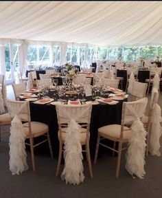 Our pretty chiffon ruffle hoods look timeless and elegant seen here against navy table covers