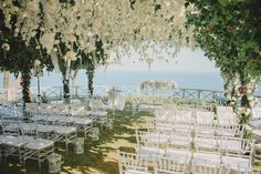 Bali wedding with beautiful arbour of white roses and orchids // Steven and Katarina's Bali Wedding With a Lush Floral Arbour