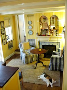 love the blue and yellow, stripes, checks, delft tiles around fireplace--so charming