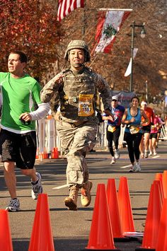 2nd Lt. Sophie Hilaire '09 sprints to the finish of the Philadelphia Marathon, setting a Guinness World Record for women by running the Nov. 22 race in 4 hours 54 minutes wearing full battle rattle.