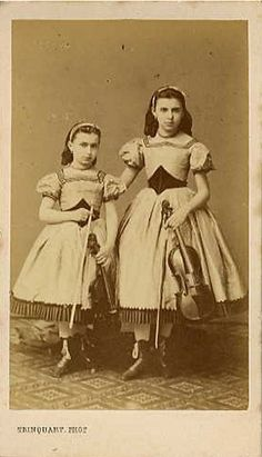 Two girls with their instruments, 1800s.