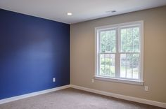 Master suite with blue royal blue accent wall ©Balducci Builders