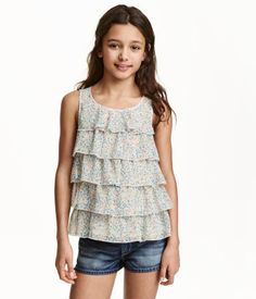 $14.99 - Sleeveless top in woven fabric with airy chiffon tiers. Opening at back of neck with button.