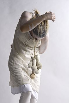 """ISABEL MANIA  Hunters and Gatherers"""" necklace, 2011. Yarn, paint, brass."""