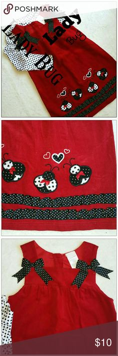 Lady Bug Jumper and Heart Mock Neck Top Red thin whale corduroy jumper with black and white ruffles, bow trim and lady bug appliques. Comes with coordinating black and white, heart print long sleeve knit shirt. Must be bundled with another item to purchase. Matching Sets