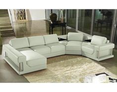 This white leather sectional is confident and contemporary, bold and modern. The seductive and distinctive design is highlighted by sleek polished metal accents. This furniture piece offers superior comfort and urban style.
